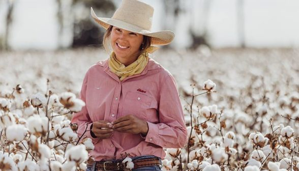 Millie-bach-standing-in-a-cotton-field